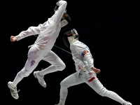 Ace Eldeib in action against Poland's Majgier in the Cadet Men's Epee event.