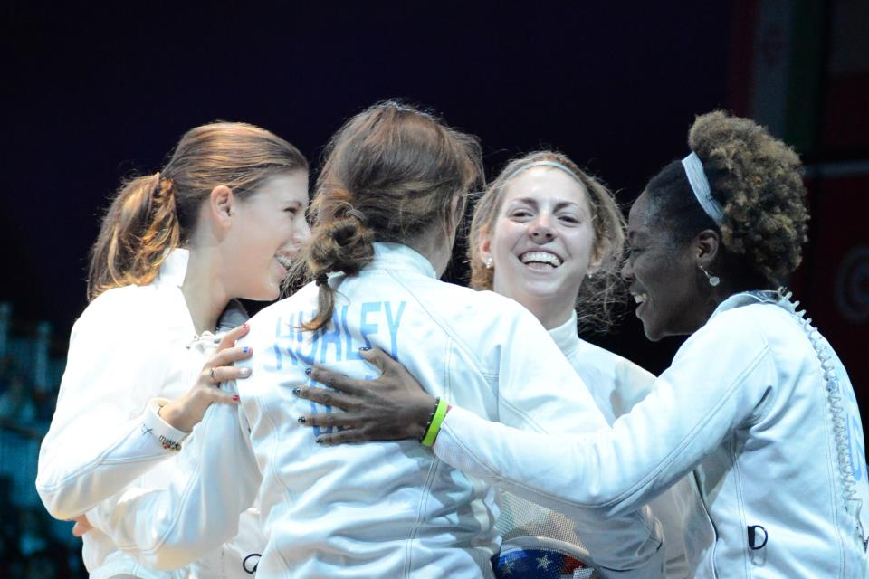 The US Women's Epee Team of Kelley Hurley, Courtney Hurley, Susie Scanlan, and Maya Lawrence defeated Italy in their opening round match.  Photo Craig Harkins