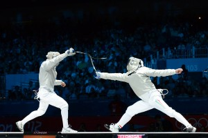 Ochiuzzi (ITA, left) in action at the 2012 Olympics - Men's Sabre.  Photo C. Harkins / Fencing.Net