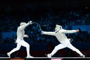 Ochiuzzi (ITA, left) in action at the 2012 Olympics - Men's Sabre.  Photo C. Harkins / Fencing.Net