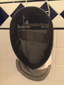 hang drying a fencing mask