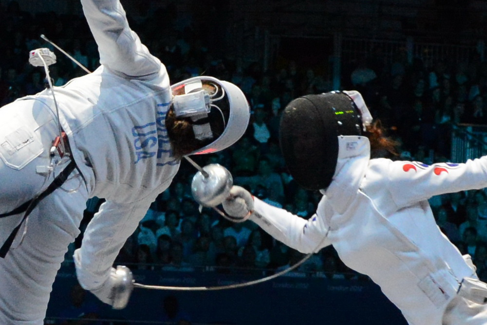 Courtney Hurley fights for Team USA in their semi-final match against Korea